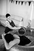 Kelly supporting a doula client during her labour by pouring warm water over her back during her homebirth in Adelaide